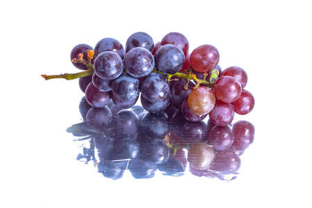 Red grape isolated on white backgrounds