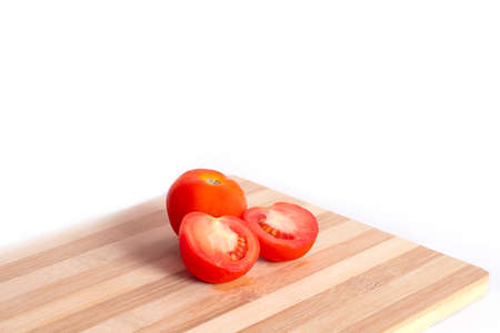 chopped tomatoes on cutting board isolated on the white backgrounds.