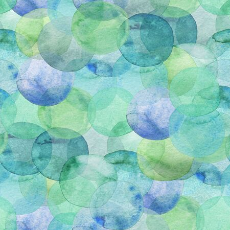 Seamless pattern of green and blue translucent watercolor circles. Hand painted Spots on a white background. Round. Isolated. Blobs of different colors