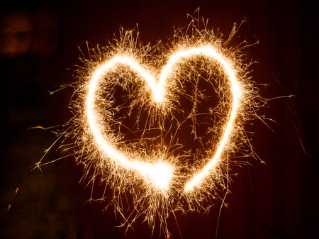 spectre: A Heart symbol painted with sparklers light Stock Photo