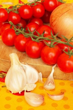 mediteranean: Typical ingredients of mediteranean cuisine -tomatoes and garlic Stock Photo
