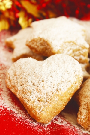 powdered sugar: Heart shaped cookies covered with powdered sugar Stock Photo
