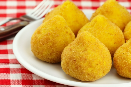 region sicilian: Arancini - deep fried stuffed rice balls typical of Sicily
