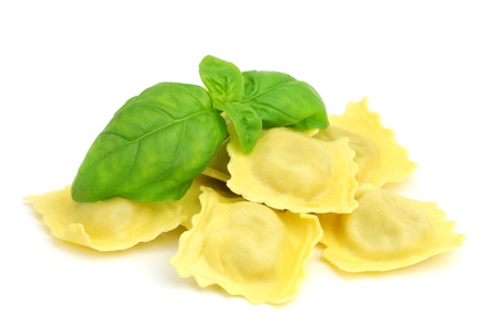 Italian ravioli with fresh basil on white background