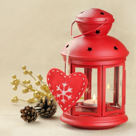 Christmas lantern with pine cones and heart shaped ornament  photo