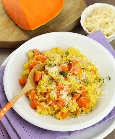 talian: talian pumpkin risotto - Risotto alla zucca - on a white plate