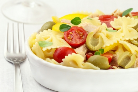 pasta salad: Bow tie pasta salad with tuna, cherry tomatoes, yellow bell pepper and green olives