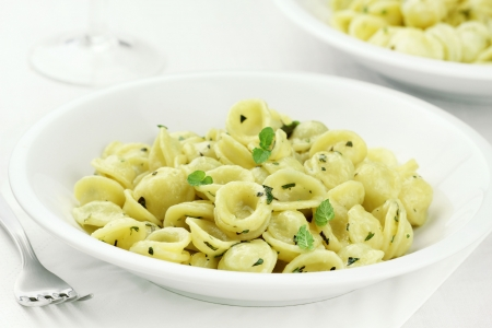 sage: Orecchiette - typical pasta of Apulia region of southern Italy - with aromatic herbs and parmesan
