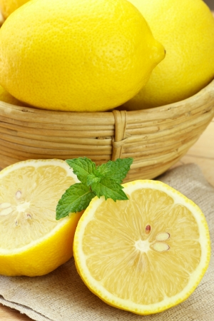 cid: Lemon cut in half and a sprig of fresh mint  Stock Photo