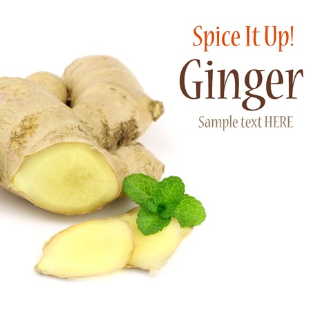 Sliced fresh ginger root with a mint sprig on white background with copy space