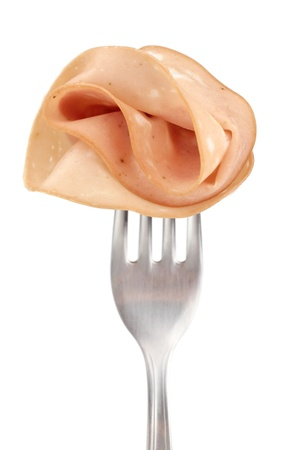 bologna: Thin slice of Italian sausage Mortadella on fork on white background  Stock Photo