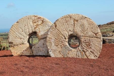 millstone: Old millstones in Cactus garden in Lanzarote, Canary islands, Spain