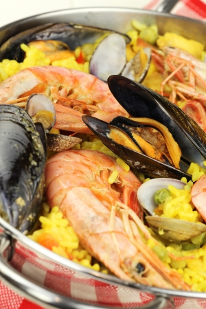 Traditional Spanish seafood paella with clams, mussels and king prawns  photo
