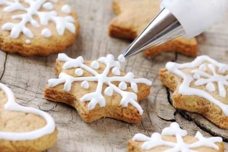 christmas baker's: Christmas cookie icing decoration with pastry bag Stock Photo