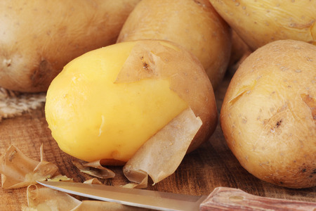 Potatoes boiled in their skins in the process of peeling them off
