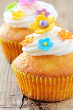 buttercream: Delicious cupcakes decorated with colourful sugar paste flowers and buttercream