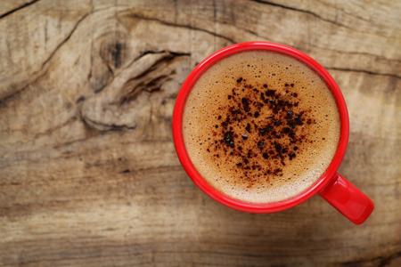 nice day: Good morning or Have a nice day message concept - bright red cup of frothy coffee with copy space Stock Photo