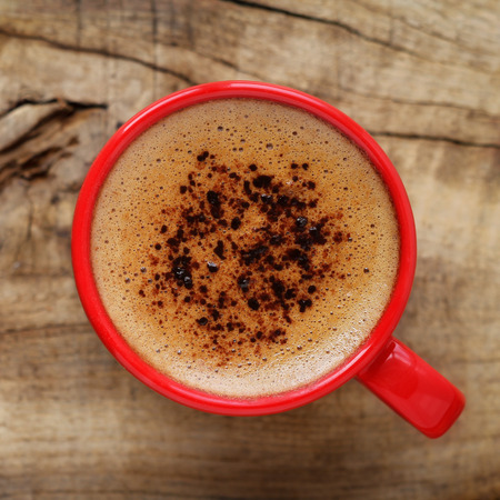 breakfast smiley face: Good morning or Have a nice day message concept - bright red cup of frothy coffee with copy space Stock Photo