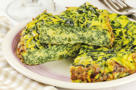 omelette: Homemade Italian spinach or Swiss chard frittata - baked spinach omelet Stock Photo