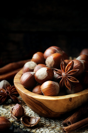 cobnut: Hazelnuts with star anise and cinnamon sticks - Traditional winter holiday Christmas baking ingredients and spices