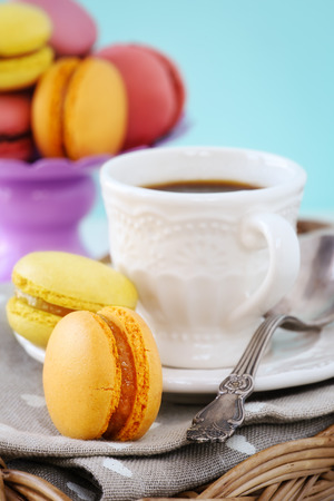 nice day: Good morning or Have a nice day message concept - espresso coffee with colourful French macarons for breakfast Stock Photo
