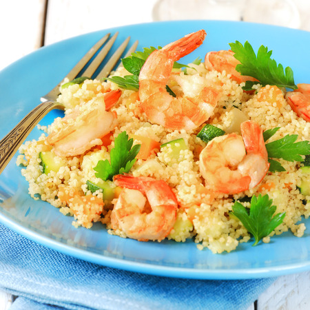 turquise: Couscous with vegetables and shrimps on a turquise plate