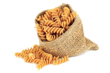 whole grain: Whole wheat or whole grain fusilli - dry Italian pasta - isolated on white background Stock Photo