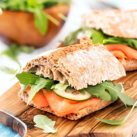 multi grain sandwich: Multi grain ciabatta sandwich with smoked salmon, fresh cucumber and arugula salad leaves