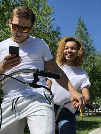 young beautiful couple riding a bicycle