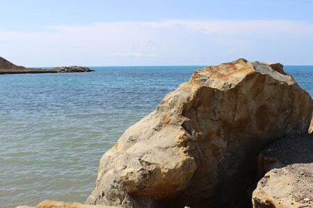 beautiful authentic sea from the rocky shore. The natural nature of the sea without treatment. Stock fotó