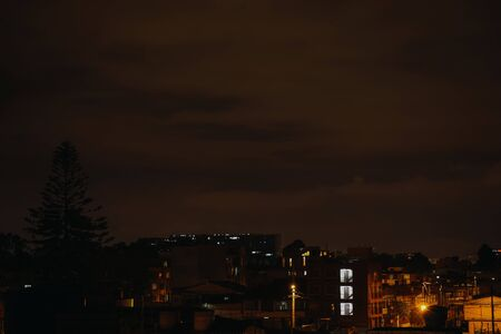 city  rests in the night of chaos illuminated with artificial light