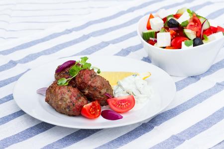 tzaziki: Greek bifteki with tzatziki and greek salad Stock Photo