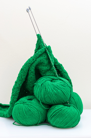 Balls and Knitting Needles fishermans rib pattern Stock Photo