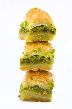 Baklava with pistachio on a white background