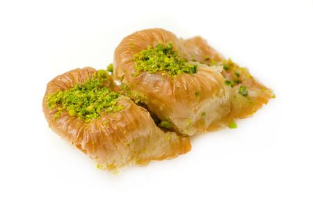 baklava: Baklava with pistachio on a white background