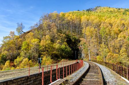 Autumn Circum-Baikal Railway on south lake Baikal with backpacker Stock Photo
