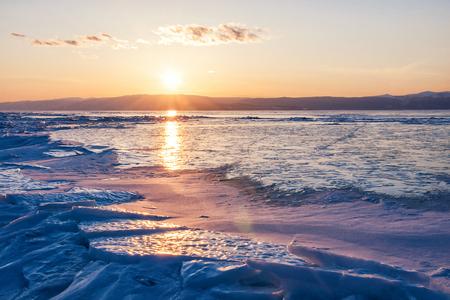 baical: Sunset on the lake Baikal in winter Stock Photo