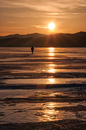 baical: Sunset on the lake Baikal in winter with silhouette of man