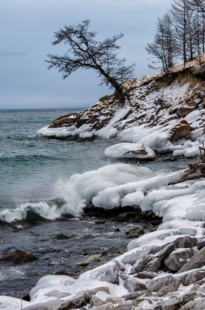 Waves and splash on Lake Baikal with rocks and trees in Uzuri bay Stock Photo