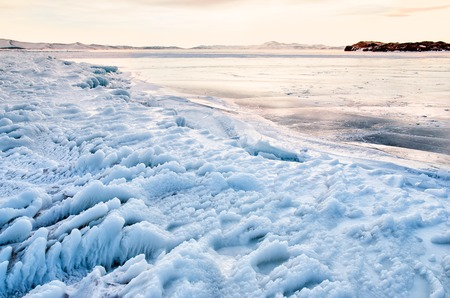 Ice floes floating on the fog water in the lake Baikal, Russia. Sunset Standard-Bild