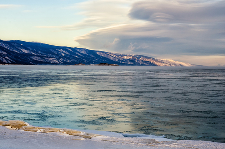 Ice floes floating on the fog water in the lake Baikal. Sunset Stock Photo