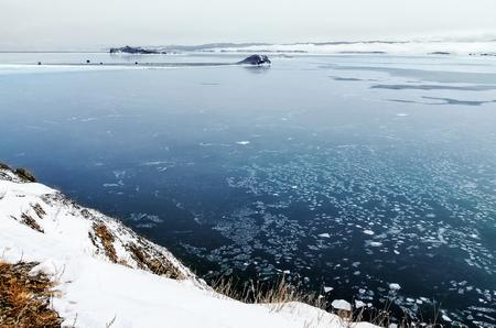 View above big beautiful lake and mountain in winter, Baikal lake, Russia