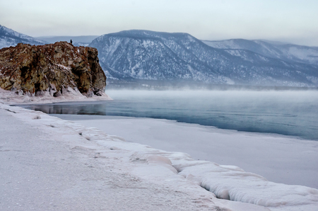 Field of ice hummocks and rock on the frozen Lake Baikal. Sunset