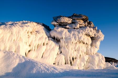 Ice dragon from frozen rock, fantastic winter landscape, closeup