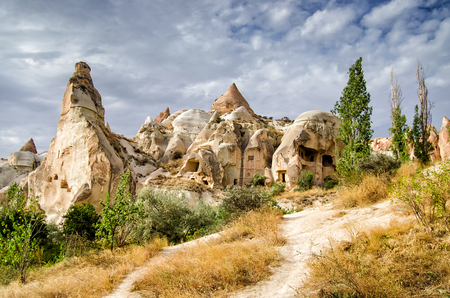 Ancient cavetown near Goreme, Cappadocia, Turkey Stock Photo