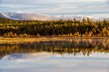 Lake and mountains of Siberia with reflection