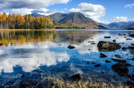 Mountain lake Froliha with stones and reflection, near lake Baikal