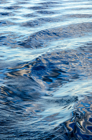 Waves on surface of water with cloudy sky. Deep blue color 写真素材