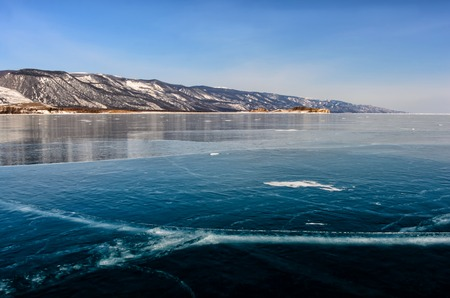 View of beautiful drawings on ice from cracks and bubbles of deep gas on surface of Baikal lake in winter, Russia Stok Fotoğraf