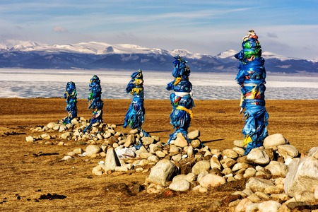 Sacred place with obo. Winter landscape of Mongolia. Lake Khubsugul and mountain